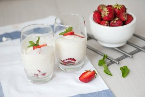 dessert with strawberries on a white wood background