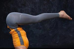 Woman doing Hatha yoga Ashtanga Vinyasa Yoga asana sirsasana Urd