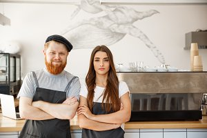 Coffee Business Concept - Portrait of small business partners standing together at their coffee shop