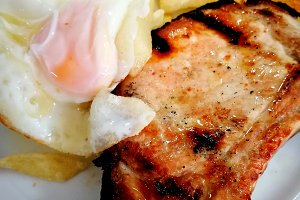 Roasted pork chop with fried egg