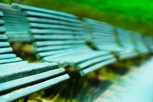Diagonal park benches bokeh background