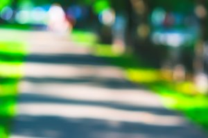 Diagonal park path bokeh background