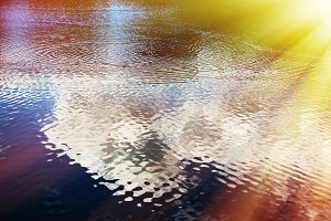 Dramatic light leak on water surface background