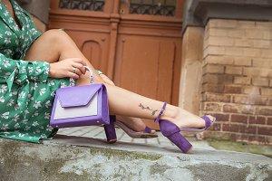 Young woman with purple handbag