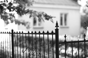City park fence view on bokeh house backdrop