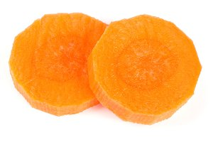 Chopped carrot slices isolated on white background