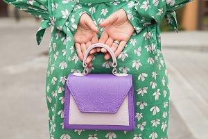 Stylish woman with purple handbag