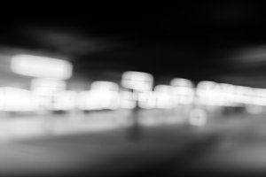 Diagonal black and white lights bokeh background