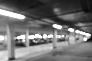 Diagonal black and white car parking bokeh background