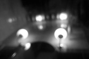 Diagonal black and white lamp illumination bokeh background