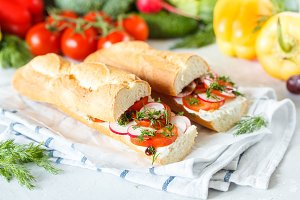 Summer sandwiches with baguette, cheese and tomatoes