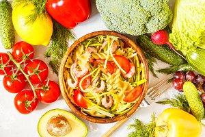 Vegetarian pasta with zucchini and shrimps.