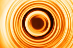 Orange motion blur teleport swirl background