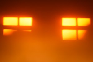 Two orange windows silhouettes bokeh background