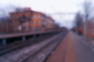 Diagonal railroad track bokeh background