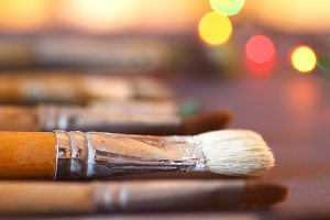 Artistic brushes on the table.