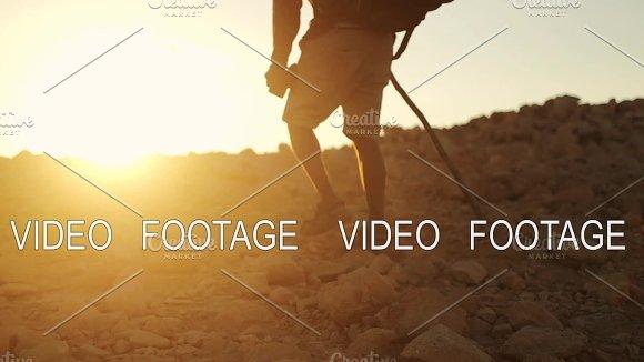 Dark Skin Traveler With Hiking Backpack Walk In The Desert On Sunset Time