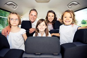 Family Sitting Inside Their Car