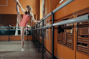 Graceful girl ballerina practicing in the Studio, elements of acrobatic