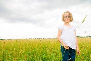Little Girl On Green Meadow