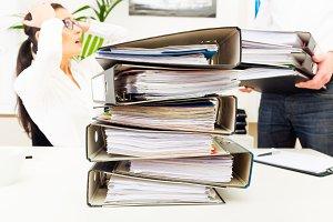 Overworked Secretary With Folders