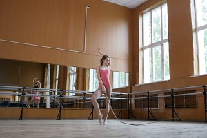 Dance with whip - girl gymnast perform circus exercise