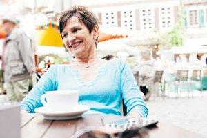 Senior Woman Enjoying A Cup Of Coffee