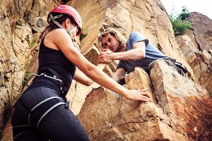 Young Climbers Rock Climbing In Old Quarry