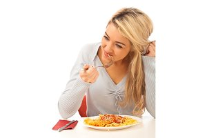 Young Woman Having Spaghetti