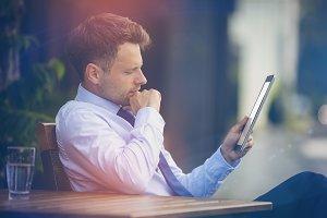 Businessman looking at digital tablet