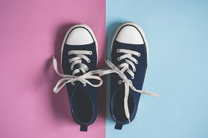 female or male Dark blue Sneakers on pink blue pastel background