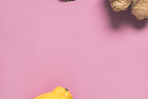 flat lay Pink background with lemon, mint leaves and ginger. Cooking and health concept