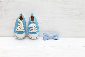 Bow tie and children's blue sneakers