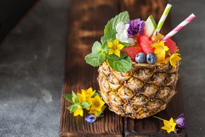 Exotic fruit salad in pineapple half