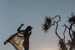 Silhouette woman in wind