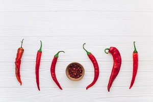 Chili red on a wooden background.