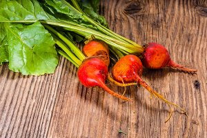 Orange beets on wooden table