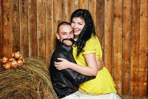 Young couple on hayloft