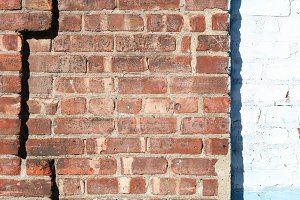 Red Brick Wall beside White Brick