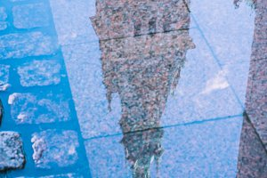 Reflection of City Hall Tower in a puddle. Hamburg, Germany