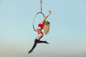 Woman acrobat in the air.