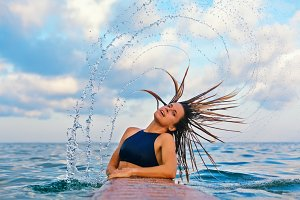 Surfer girl flip hair with splashes