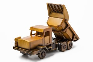 Dump truck toy car made of wood.