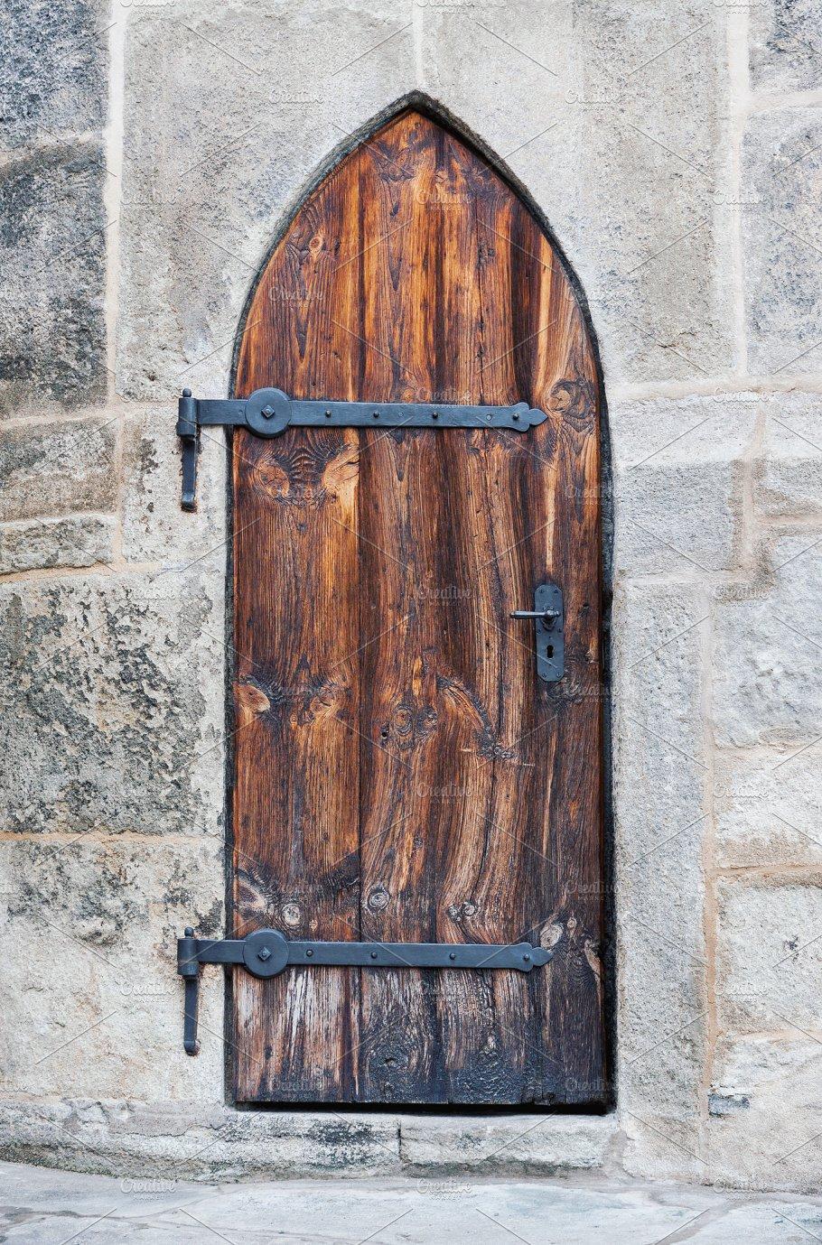 Wooden medieval castle doors ~ Architecture Photos ~ Creative Market