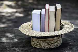 A stack of books in a straw hat