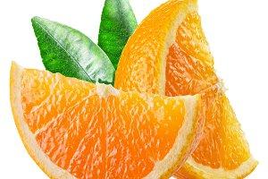 segments of orange fruit with leaves