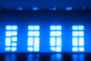Blue room with multiple windows bokeh