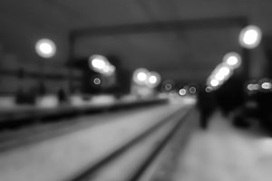 Diagonal black and white railway track bokeh background