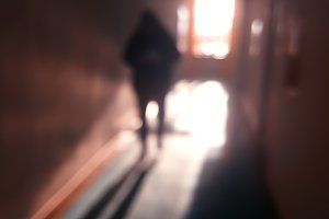 Vertical man in office corridor bokeh background