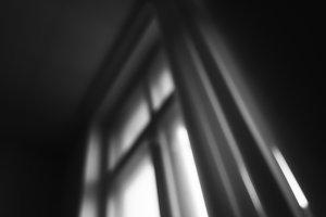 Diagonal black and white windows bokeh background